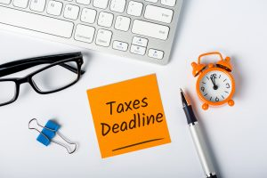 Taxes deadline or tax time - Notification of the need to file tax returns, tax form at accauntant workplace.
